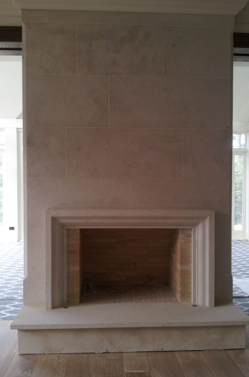 French Provincial stone fireplace surrounds and mantels