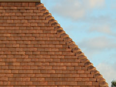 traditional terracotta shingles with hogsback ridge capping